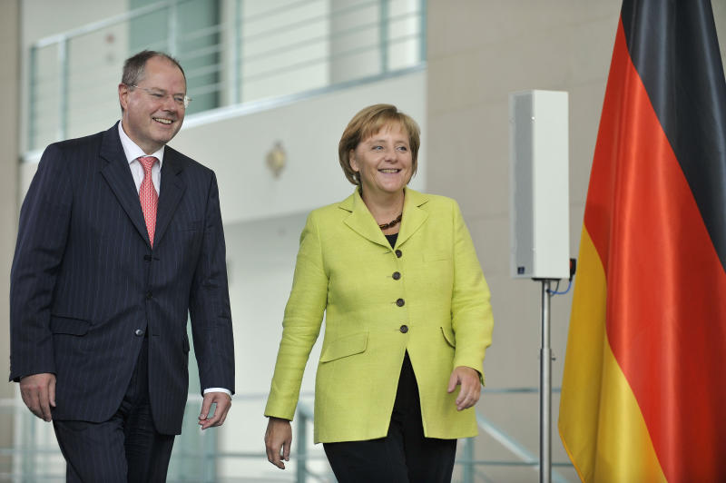 FILE - The Sept. 21, 2009 file photo shows German Chancellor Angela Merkel, right, and then German Finance Minister Peer Steinbrueck, left, after a meeting with the German Government's task force for finance architecture at the chancellery in Berlin. Germany's main opposition party appears set to choose former Finance Minister Peer Steinbrueck, who helped pilot the country through the 2008-9 financial crisis, as Chancellor Angela Merkel's challenger in next year's election. Several German media outlets reported Friday, Sept. 28, 2012 the center-left Social Democrats have decided to nominate the 65-year-old Steinbrueck. (AP Photo/Gero Breloer)