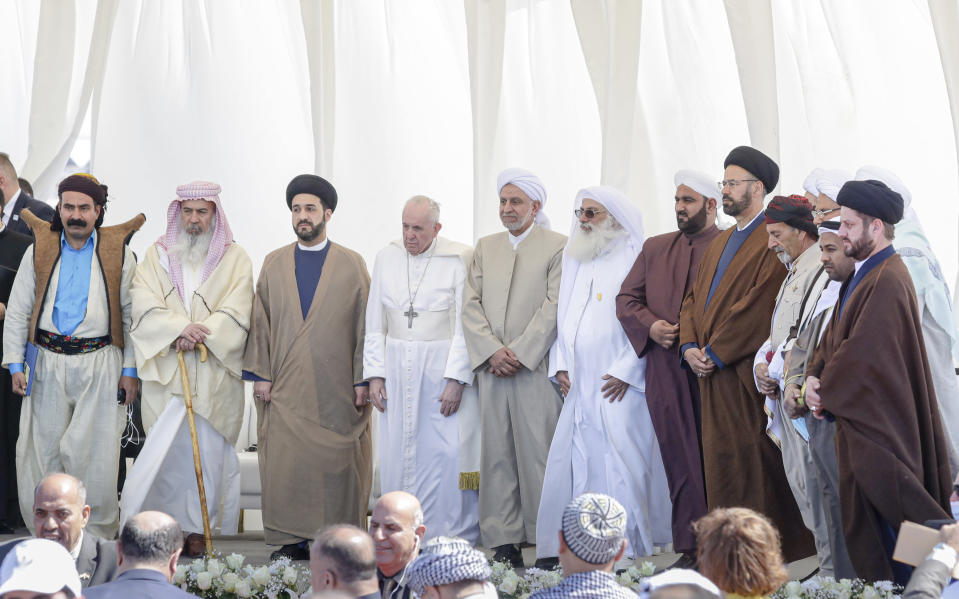 Pope Francis stands with religious leaders during an interreligious meeting near the archaeological area of the Sumerian city-state of Ur, 20 kilometers south-west of Nasiriyah, Iraq, Saturday, March 6, 2021. Ur is considered the traditional birthplace of Abraham, the prophet common to Muslims, Christians and Jews.Francis traveled to the southern ruins of Ur on Saturday to reinforce his message of interreligious tolerance and fraternity during the first-ever papal visit to Iraq, a country riven by religious and ethnic divisions. (AP Photo/Andrew Medichini)