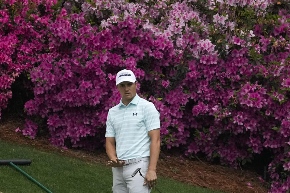 Jordan Spieth watches his putt on the 13th green during the third round of the Masters golf tournament on Saturday, April 10, 2021, in Augusta, Ga. (AP Photo/Charlie Riedel)