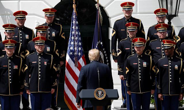 "U.S. President Donald Trump looks back at the United States Army Chorus at his ""celebration of America"" event on the South Lawn of the White House in Washington, U.S., June 5, 2018. The event was arranged after Trump canceled the planned visit of the Super Bowl champion Philadelphia Eagles to the White House. REUTERS/Kevin Lamarque"
