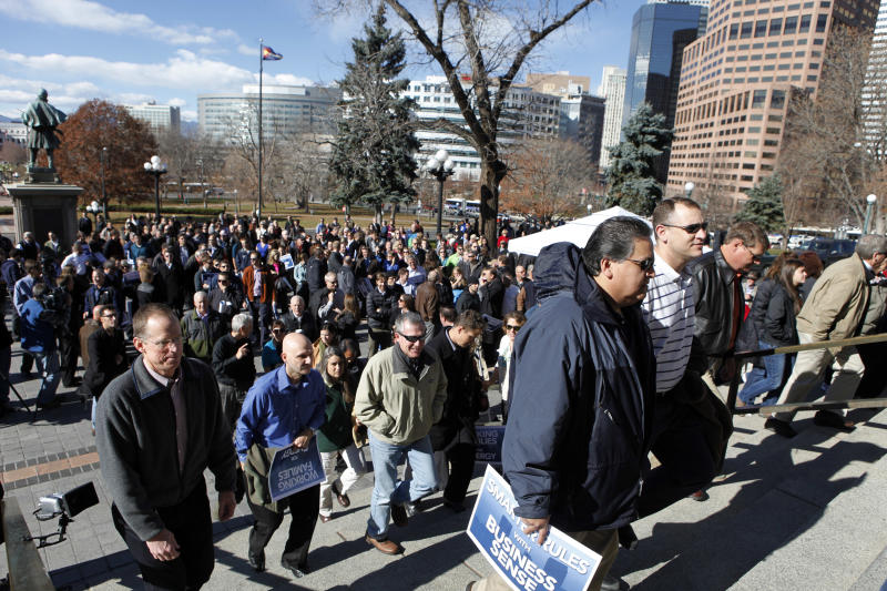 Supporters of fracking climb the steps for a rally at the Capitol in Denver on Tuesday, Nov. 13, 2012. The rally hosted by the greater Colorado business community was held to show support that oil and gas can and should be developed responsibly in Colorado.  (AP Photo/Ed Andrieski)