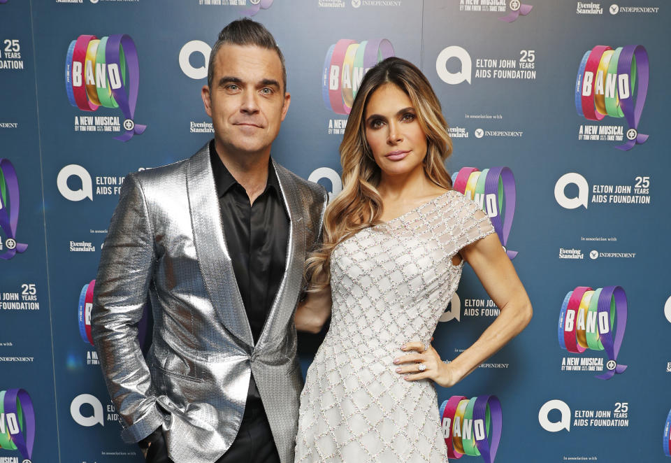"Robbie Williams and Ayda Field attend  the Opening Night Gala of ""The Band"" to benefit the Elton John AIDS Foundation supported by The Evening Standard at Theatre Royal Haymarket on December 4, 2018 in London, England.  (Photo by David M. Benett/Dave Benett/Getty Images)"