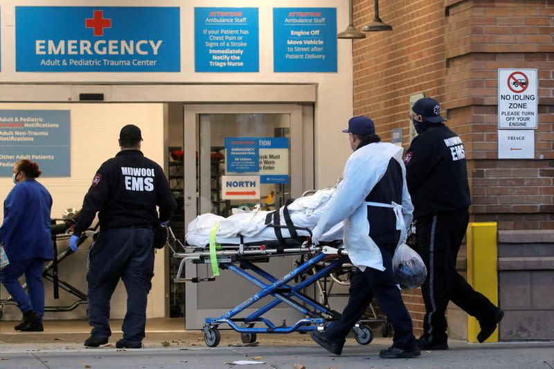 A patient arrives outside Maimonides Medical Center, as the spread of the coronavirus disease (COVID-19) continues, in Brooklyn, New York