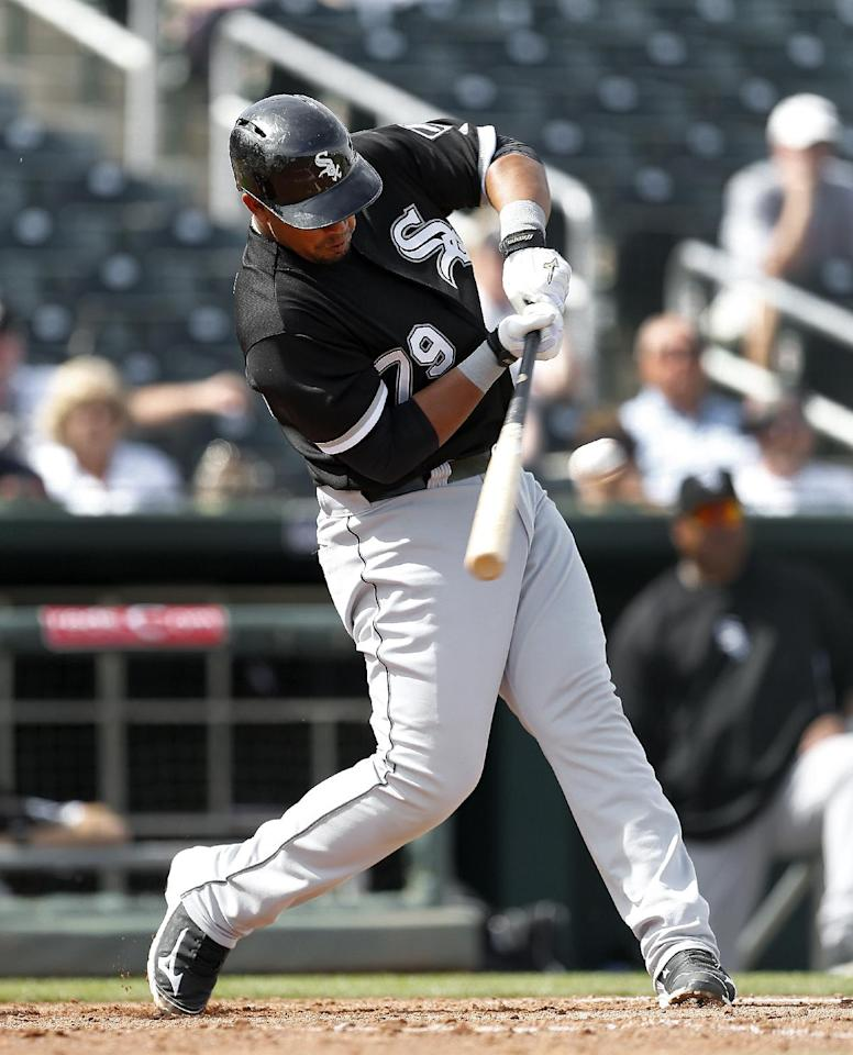 Chicago White Sox's Jose Abreu hits a two-run double against the Cleveland Indians during an exhibition baseball game in Goodyear, Ariz., Tuesday, March 4, 2014. (AP Photo/Paul Sancya)