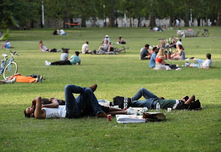 People relaxing in St James's Park, London (Picture: Getty)