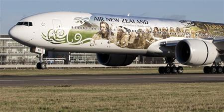 An Air New Zealand's Boeing 777-300ER featuring livery advertising the film The Hobbit: An Unexpected Journey lands at Heathrow Airport in London