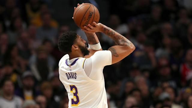 Anthony Davis battled through illness as the LA Lakers saw off the Denver Nuggets and earned praise from team-mate LeBron James.