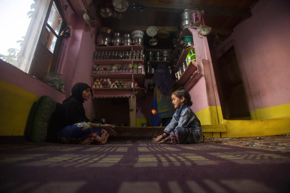Haseena,8, right and Muskan, 14, play inside their home at Dardkhor village, where several cases of wild animals attacking villagers have been reported, in Srinagar, Indian controlled Kashmir, Monday, Aug. 24, 2020. Amid the long-raging deadly strife in Indian-controlled Kashmir, another conflict is silently taking its toll on the Himalayan region's residents: the conflict between man and wild animals. According to official data, at least 67 people have been killed and 940 others injured in the past five years in attacks by wild animals in the famed Kashmir Valley, a vast collection of alpine forests, connected wetlands and waterways known as much for its idyllic vistas as for its decades-long armed conflict between Indian troops and rebels. (AP Photo/Mukhtar Khan)