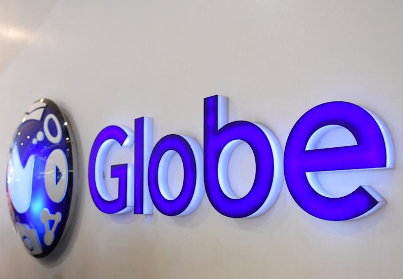 FILE PHOTO: A logo of Globe Telecom is seen at a Globe service center in Edsa, Quezon City, Metro Manila, Philippines. REUTERS/Dondi Tawatao