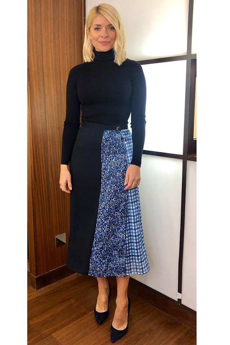 4c437c9e637732 Style Notes: A roll-neck and midi skirt is a great option for work. We're  taking our cues from Holly and keeping our parings tonal. Navy is a great  option.