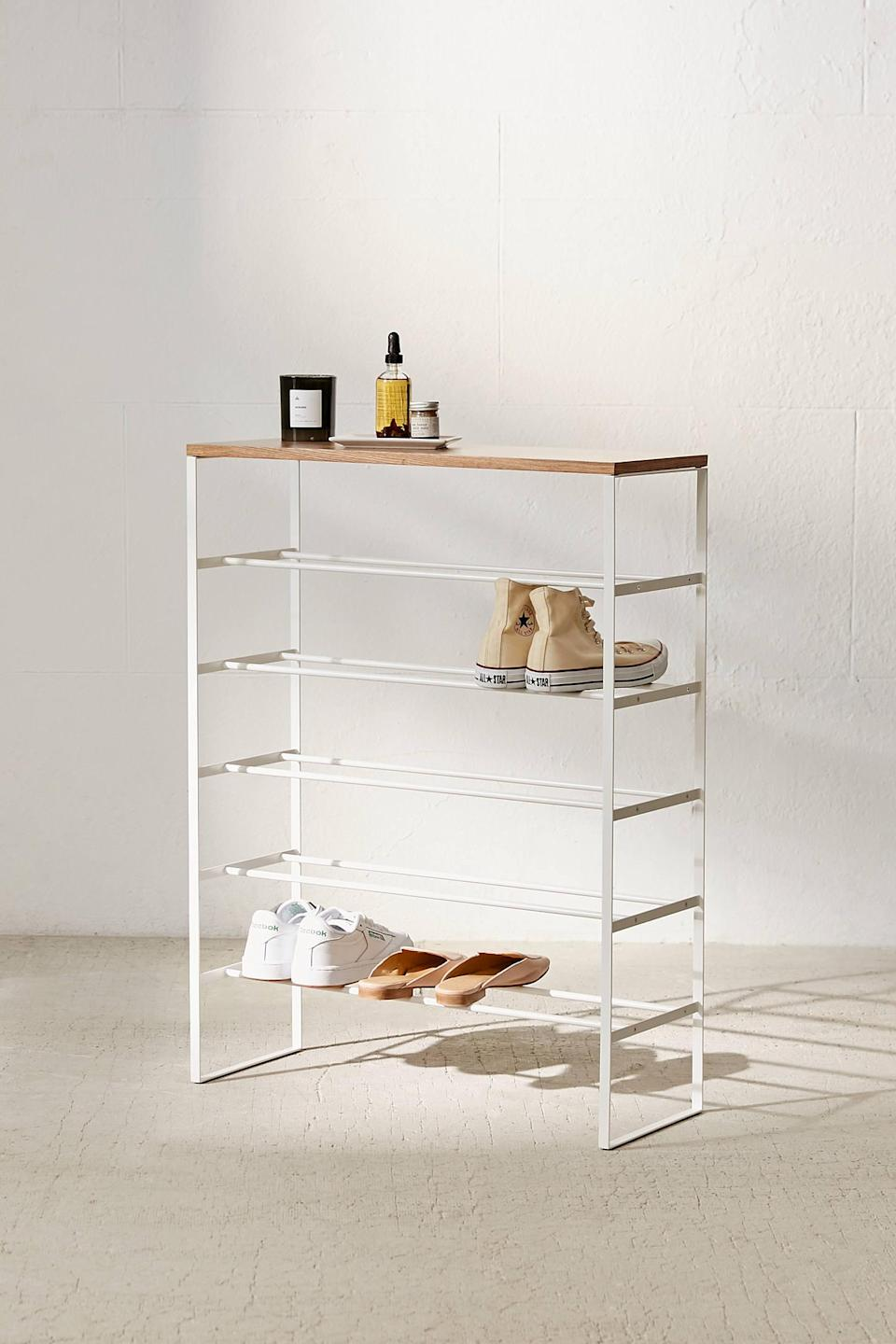 """<h2>Yamazaki Shoe Rack</h2><br>For the beginner organizer in your life, have them start with something easy like decluttering their shoe collection.<br><br><strong>Yamazaki</strong> 6-Tier Shoe Rack, $, available at <a href=""""https://go.skimresources.com/?id=30283X879131&url=https%3A%2F%2Fwww.urbanoutfitters.com%2Fshop%2F6-tier-shoe-rack%3Fcolor%3D010%26type%3DREGULAR%26size%3DONE%2520SIZE%26quantity%3D1"""" rel=""""nofollow noopener"""" target=""""_blank"""" data-ylk=""""slk:Urban Outfitters"""" class=""""link rapid-noclick-resp"""">Urban Outfitters</a>"""