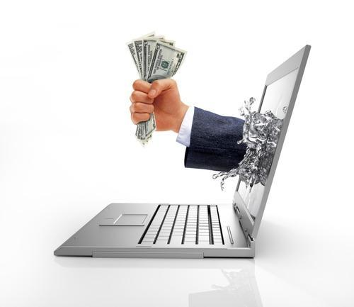 Illustration of a hand grasping several bills coming out a laptop screen