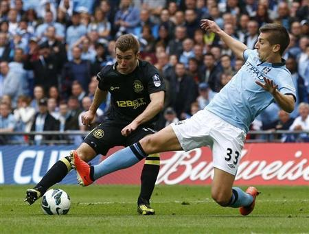 Wigan Athletic's Callum McManaman is challenged by Manchester City's Matija Nastasic during their FA Cup final soccer match at Wembley Stadium in London