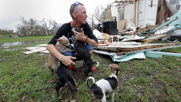 PHOTO: Sam Speights tries to hold back tears while holding his dogs and surveying the damage to his home in the wake of Hurricane Harvey, Aug. 27, 2017, in Rockport, Texas. (Eric Gay/AP)