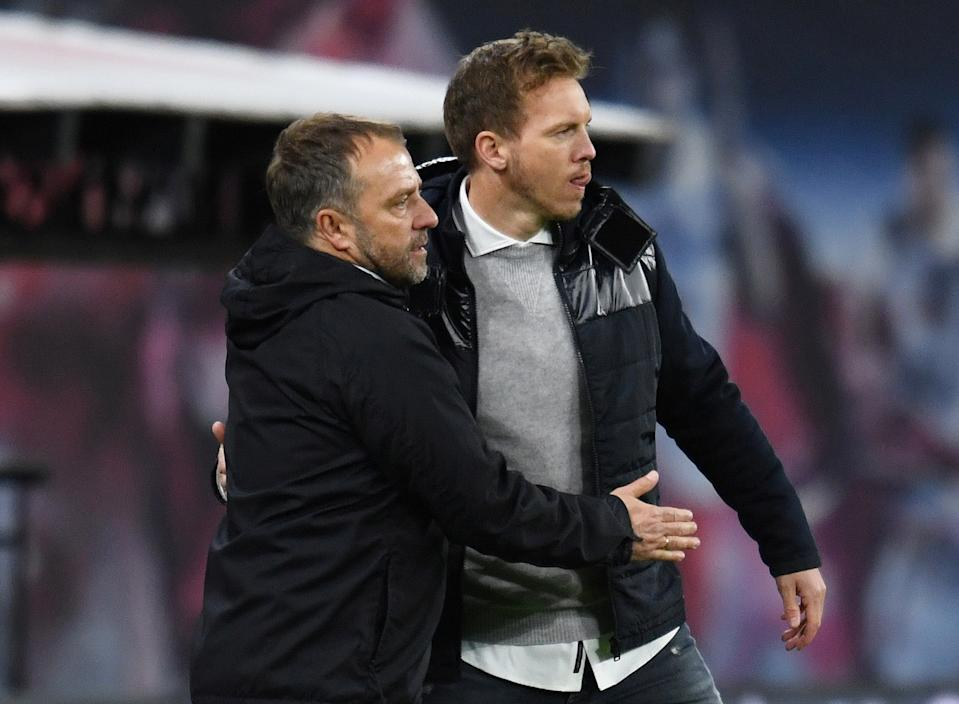 FILE PHOTO: Soccer Football - Bundesliga - RB Leipzig v Bayern Munich - Red Bull Arena, Leipzig, Germany - April 3, 2021 Bayern Munich coach Hansi Flick with RB Leipzig coach Julian Nagelsmann after the match Pool via REUTERS/Annegret Hilse/File Photo DFL regulations prohibit any use of photographs as image sequences and/or quasi-video.