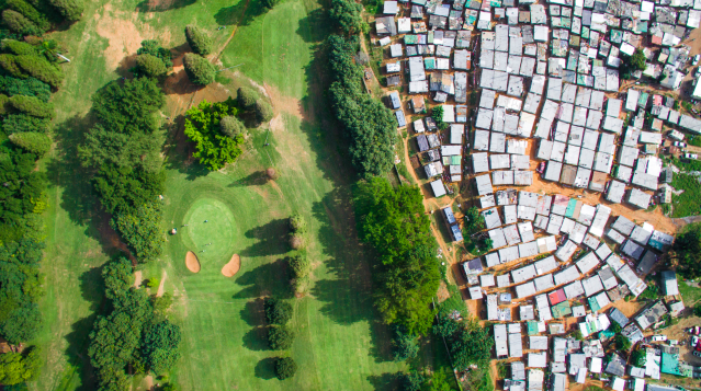 <p>Golfers enjoy a day out close to where people live on the breadline in Ethiopia (MediaiDrumWorld/Johnny Miller) </p>