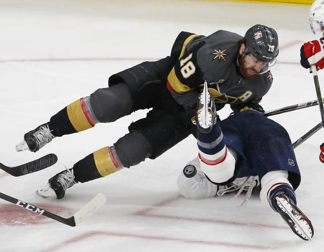 Vegas Golden Knights left wing James Neal, left, collides with Washington Capitals right wing Tom Wilson during the third period in Game 2 of the NHL hockey Stanley Cup Finals on Wednesday, May 30, 2018, in Las Vegas. (AP Photo/Ross D. Franklin)