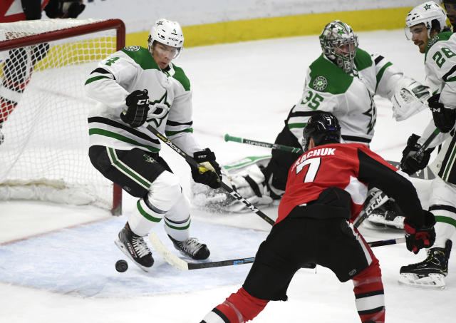 Ottawa Senators left wing Brady Tkachuk (7) scores past Dallas Stars defenseman Miro Heiskanen (4) and goaltender Anton Khudobin (35) during the first period of an NHL hockey game Sunday, Feb. 16, 2020, in Ottawa, Ontario. (Justin Tang/The Canadian Press via AP)