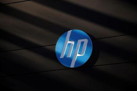 FILE PHOTO - A Hewlett-Packard logo is seen at the company's Executive Briefing Center in Palo Alto, California January 16, 2013. REUTERS/Stephen Lam/File Photo