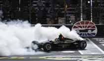 FILE - In this June 8, 2019, file photo, Josef Newgarden does a burnout after winning the IndyCar auto race at Texas Motor Speedway in Fort Worth, Texas. IndyCar opens its pandemic-delayed season with an all-in-one-day show Saturday on the fast high-banked 1 -mile oval at Texas Motor Speedway, more than eight months after the 2019 finale. (AP Photo/Larry Papke, File)