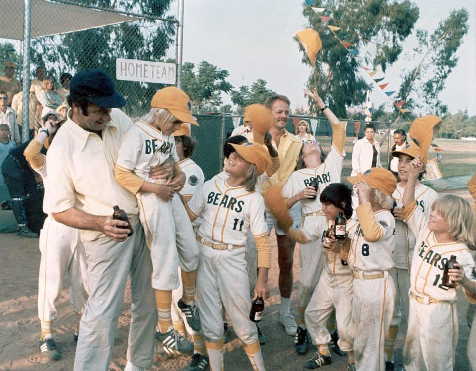 "Walter Matthau (far left) coaches the team to victory in ""The Bad News Bears."""