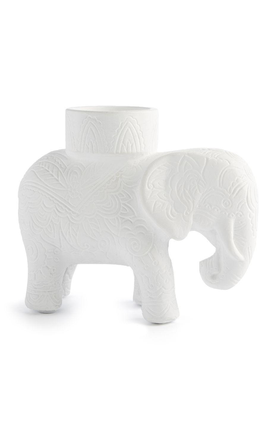 <p>Elephant candle holder, price unknown</p>