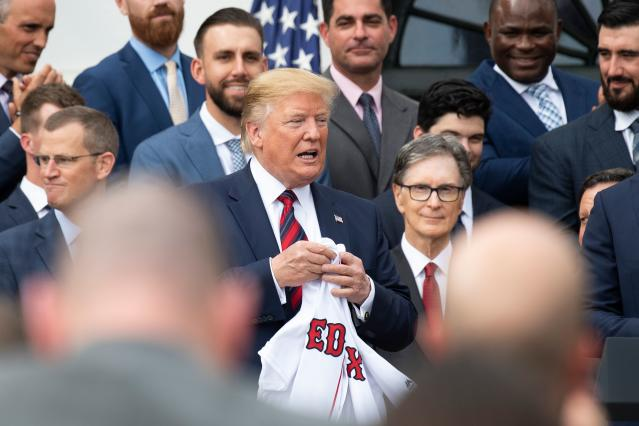 US President Donald Trump (C) holds a Boston Redsox's jersey that was given to him as he welcomed the 2018 World Series Champions to the White House in Washington, DC, on May 9, 2019. (Photo by Jim WATSON / AFP) (Photo credit should read JIM WATSON/AFP/Getty Images)