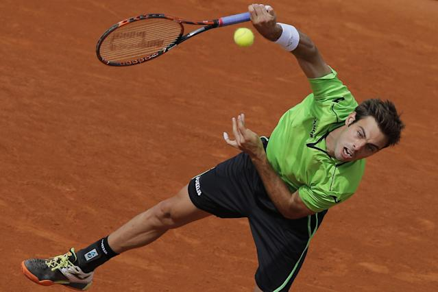 Spain's Marcel Granollers serves the ball during the fourth round match of the French Open tennis tournament against Canada's Milos Raonic at the Roland Garros stadium, in Paris, France, Sunday, June 1, 2014. (AP Photo/Michel Spingler)