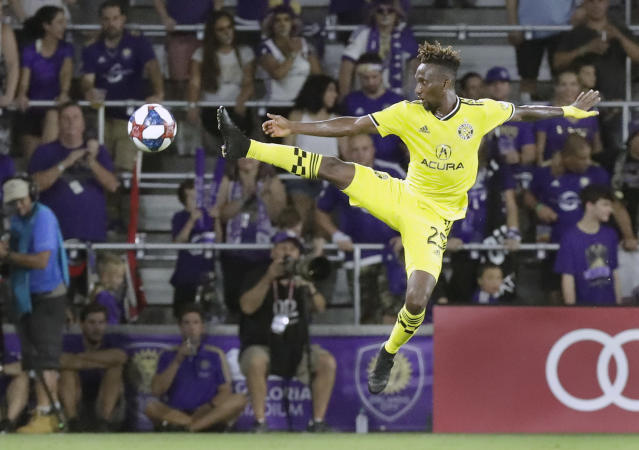 Columbus Crew's Harrison Afful tries to control a pass from a teammate during the second half of the team's MLS soccer match against Orlando City, Saturday, July 13, 2019, in Orlando, Fla. (AP Photo/John Raoux)