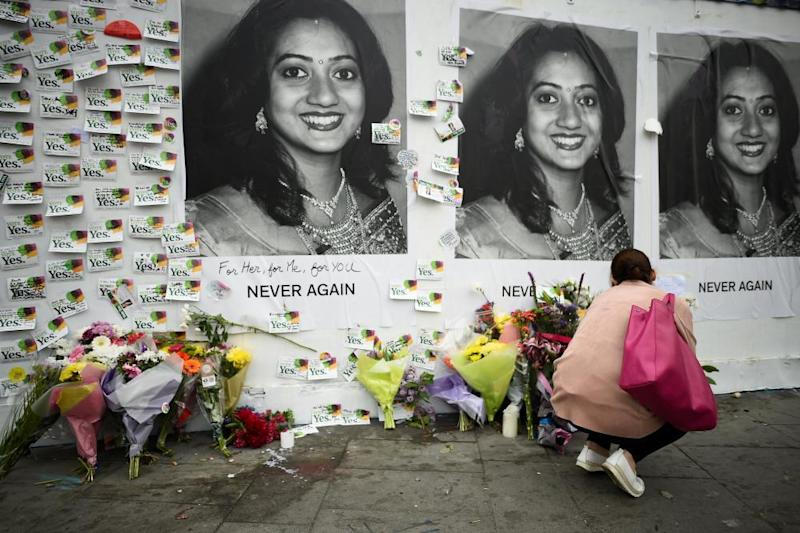 Messages are left at a memorial to Savita Halappanavar a day after an Abortion Referendum