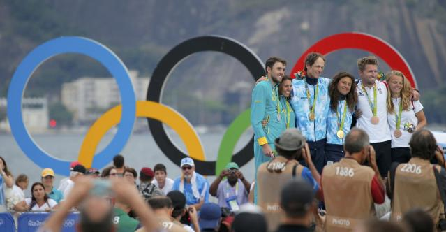 2016 Rio Olympics - Sailing - Victory Ceremony - Mixed Multihull - Nacra 17 - Victory Ceremony - Marina de Gloria - Rio de Janeiro, Brazil - 16/08/2016. Jason Waterhouse (AUS) of Australia and Lisa Darmanin (AUS) of Australia, Santiago Lange (ARG) of Argentina and Cecilia Carranza (ARG) of Argentina and Thomas Zajac (AUT) of Austria and Tanja Frank (AUT) of Austria pose with their medals. REUTERS/Brian Snyder FOR EDITORIAL USE ONLY. NOT FOR SALE FOR MARKETING OR ADVERTISING CAMPAIGNS.
