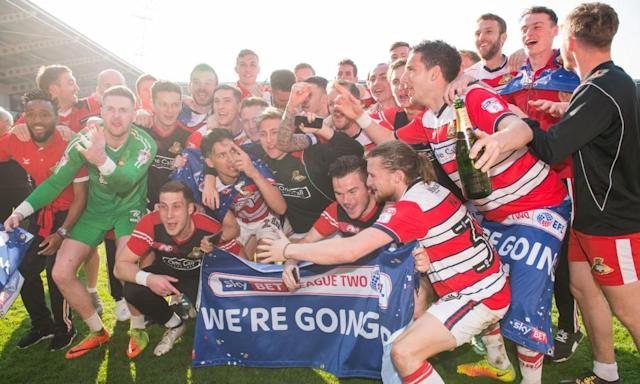 """<span class=""""element-image__caption"""">Doncaster Rovers players celebrate promotion after their League Two win against Mansfield at the Keepmoat Stadium.</span> <span class=""""element-image__credit"""">Photograph: Jon Buckle/PA</span>"""