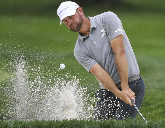 Lucas Glover hits out of the bunker on the ninth hole during the BMW Championship golf tournament in Medinah, Ill., Friday, Aug. 16, 2019. (Joe Lewnard/Daily Herald via AP)