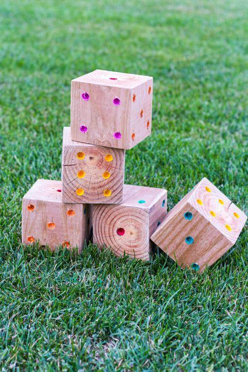 """<p>Bring the classic dice game outdoors by making these large wooden blocks with bright dots. Don't forget to sand them! </p><p><strong>Get the tutorial at <a href=""""https://designmom.com/diy-yard-yahtzee/"""" rel=""""nofollow noopener"""" target=""""_blank"""" data-ylk=""""slk:Design Mom"""" class=""""link rapid-noclick-resp"""">Design Mom</a>. </strong></p><p><a class=""""link rapid-noclick-resp"""" href=""""https://www.amazon.com/Paint-Brushes-Acrylic-Painting-pcs/dp/B08BR61H5D/?tag=syn-yahoo-20&ascsubtag=%5Bartid%7C2164.g.36687460%5Bsrc%7Cyahoo-us"""" rel=""""nofollow noopener"""" target=""""_blank"""" data-ylk=""""slk:SHOP PAINTBRUSHES"""">SHOP PAINTBRUSHES</a></p>"""