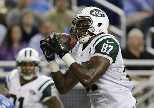 New York Jets tight end Jeff Cumberland catches the ball for a 26-yard touchdown reception during the first quarter of a preseason NFL football game against the Detroit Lions at Ford Field in Detroit, Friday, Aug. 9, 2013. (AP Photo/Duane Burleson)