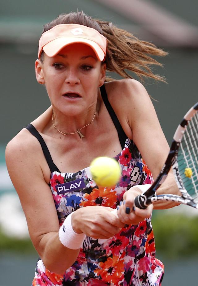 Poland's Agnieszka Radwanska returns the ball to China's Zhang Shuai during the first round match of the French Open tennis tournament at the Roland Garros stadium, in Paris, France, Sunday, May 25, 2014. (AP Photo/Darko Vojinovic)