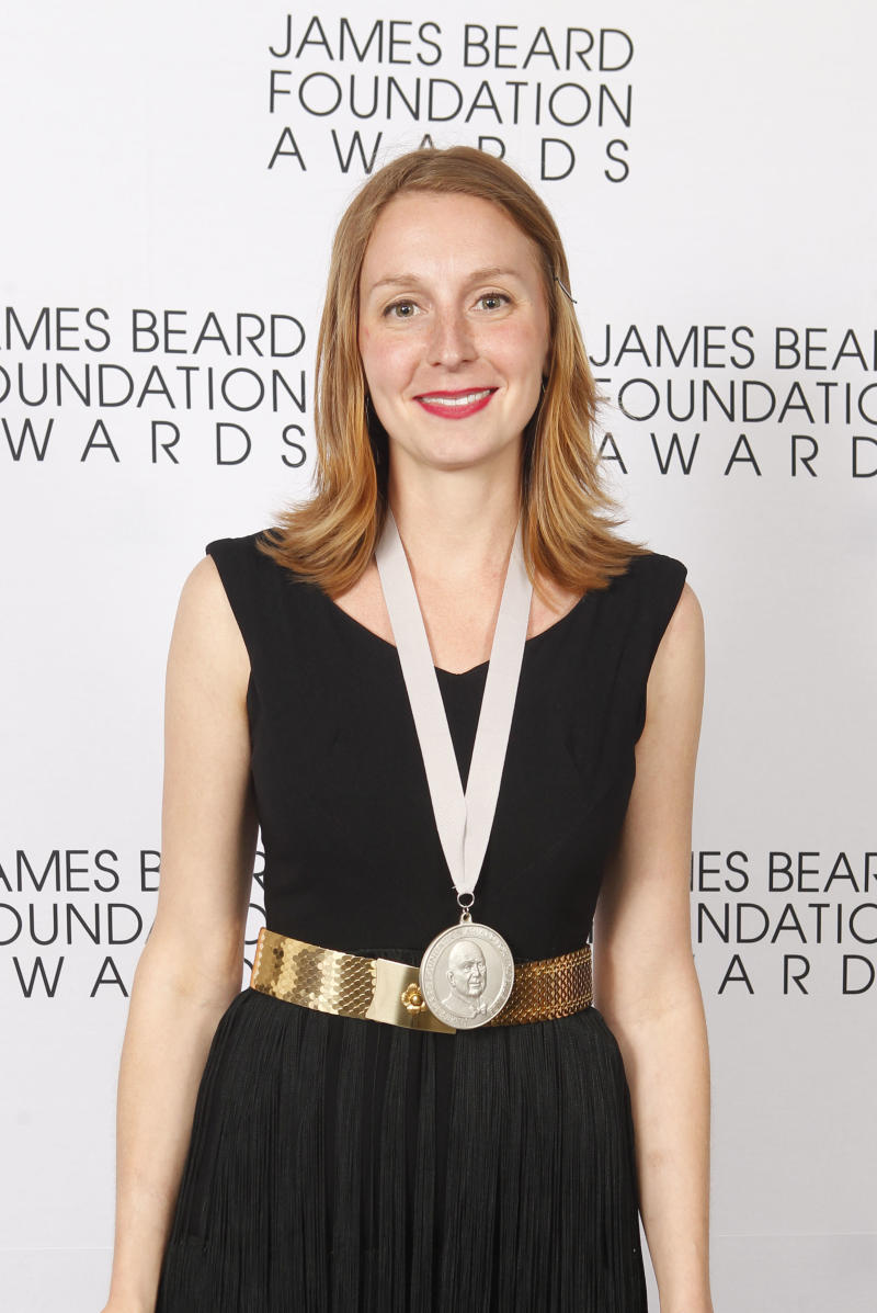 Christina Tosi, of Momofuku Milk Bar in New York, poses with her Rising Star Chef of the Year medal during the James Beard Foundation Awards, Monday, May 7, 2012, in New York. (AP Photo/Jason DeCrow)