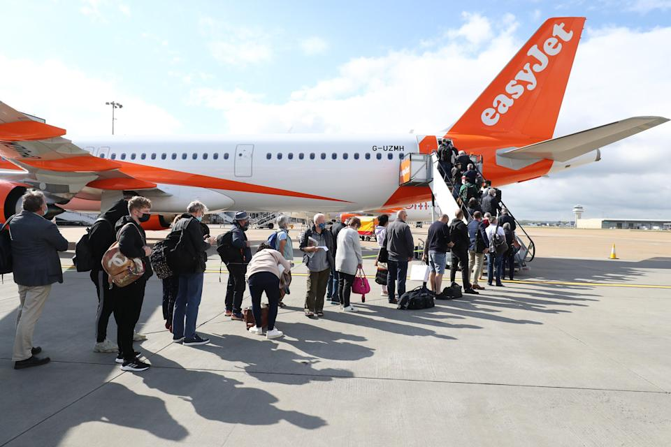 Passengers prepare to board an easyJet flight to Faro, Portugal, at Gatwick Airport in West Sussex (PA Wire)