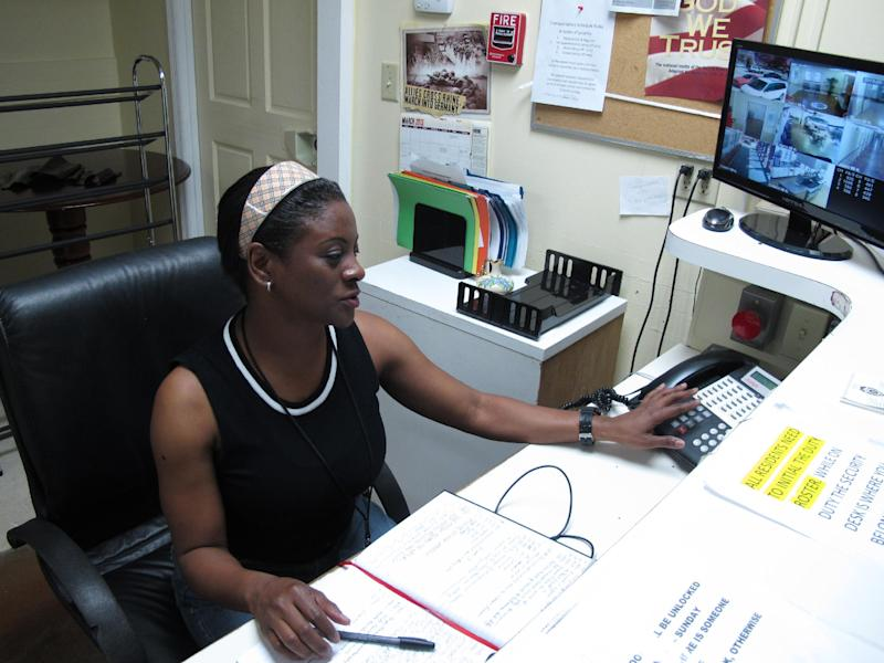 Debbie Bowman, who served 12 years in the Army, works the front desk at the Allied Veterans Center in Jacksonville, Fla., on Thursday, March 14, 2013. Bowman has been living at the shelter for homeless veterans since August. She says she lived in her car for a year before that. The center may be forced to shut down because its main source of funding was Allied Veterans of the World, which has had its leaders arrested and assets seized in an illegal gambling investigation. (AP Photo/Russ Bynum)