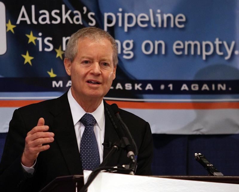 ConocoPhillips Chairman and Chief Executive Officer Jim Mulva speaks Thursday, April 7, 2011, at a breakfast meeting sponsored by the Make Alaska Competitive Coalition and the Resource Development Council at the DenaÕina Center in Anchorage, Alaska. Mulva called for changes in Alaska's oil tax structure and said his company will invest in state oil fields if that happens.  (AP Photo/Dan Joling)