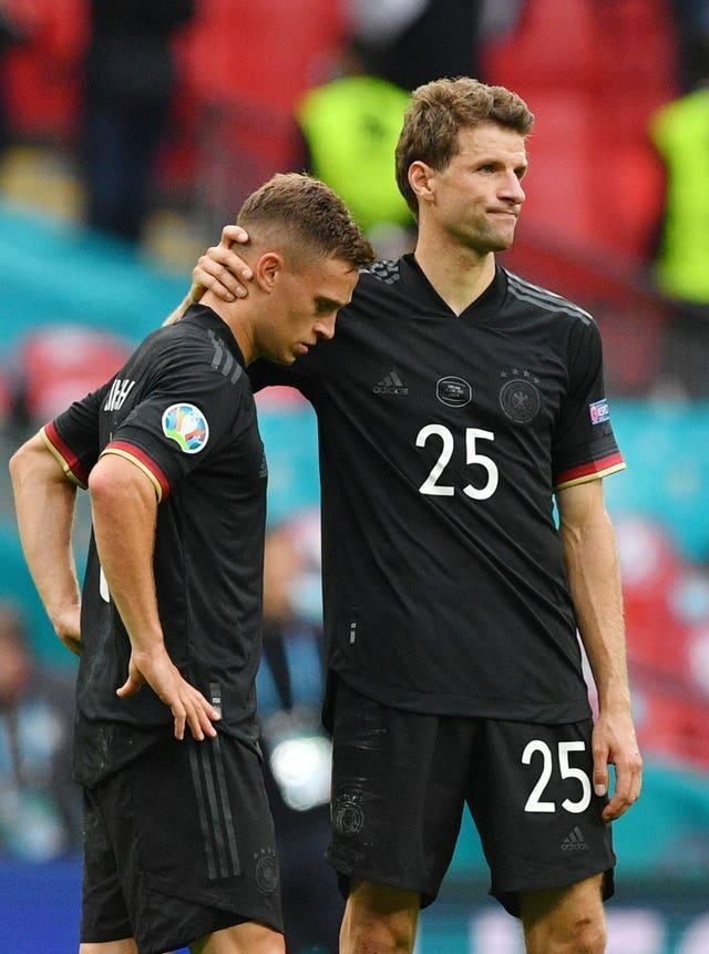 Germany's Thomas Muller, right, consoles Joshua Kimmich