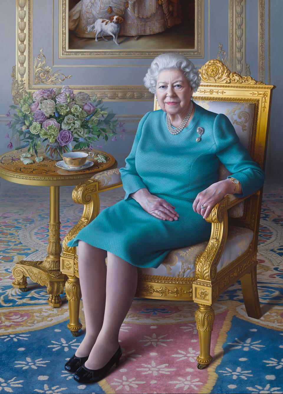 Royal portrait of Queen Elizabeth II commissioned by Foreign Office, painted by Miriam Escofet includes empty teacup