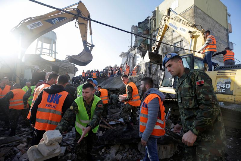 Emergency personnel work near a damaged building in Thumane, after an earthquake shook Albania, November 26, 2019. (Photo: Florion Goga/Reuters)