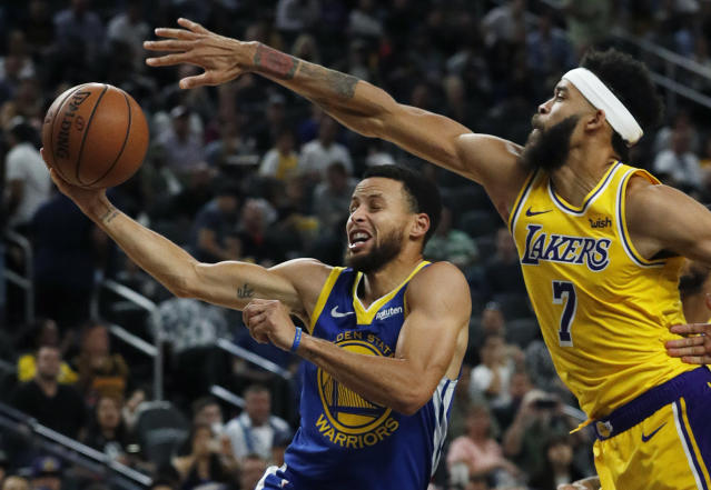 "<a class=""link rapid-noclick-resp"" href=""/nba/players/4612/"" data-ylk=""slk:Stephen Curry"">Stephen Curry</a> goes to the hole around <a class=""link rapid-noclick-resp"" href=""/nba/teams/lal"" data-ylk=""slk:Lakers"">Lakers</a> center <a class=""link rapid-noclick-resp"" href=""/nba/players/4480/"" data-ylk=""slk:JaVale McGee"">JaVale McGee</a> during Wednesday's game in Las Vegas. (AP)"
