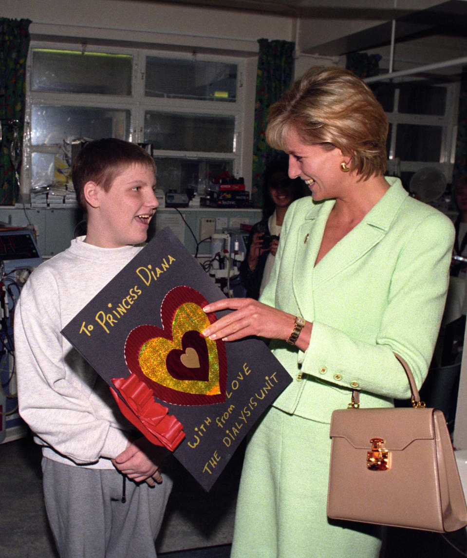 <p>Princess Diana wearing a green Chanel skirt suit to visit Great Ormond Street Hospital in February 1997 [Photo: PA] </p>