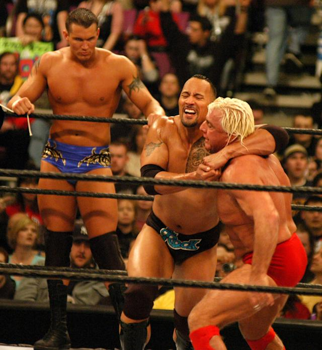 "<p>Randy Orton, Dwayne ""The Rock"" Johnson and Ric Flair are photographed during a wrestling event. (Photo by Djamilla Rosa Cochran/WireImage) </p>"