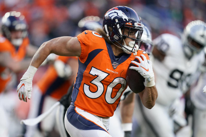 Denver Broncos running back Phillip Lindsay runs with the ball during the second half of an NFL football game against the Oakland Raiders, Sunday, Dec. 29, 2019, in Denver. (AP Photo/Jack Dempsey)