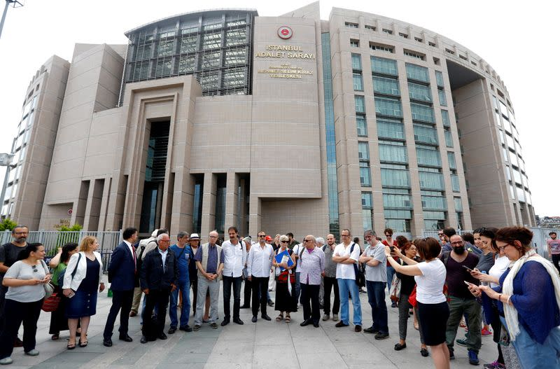 FILE PHOTO: Mater, Balikci, Turker and Eryilmaz, who were guest editors at pro-Kurdish daily Ozgur Gundem, are pictured with their fellow journalists before they appear at a court for testimony, outside the Justice Palace in Istanbul