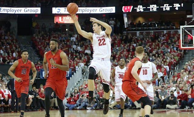 """<a class=""""link rapid-noclick-resp"""" href=""""/ncaab/players/126298/"""" data-ylk=""""slk:Ethan Happ"""">Ethan Happ</a> (22) leads Wisconsin in everything from field goal percentage and blocked shots to assists and steals. (Getty)"""