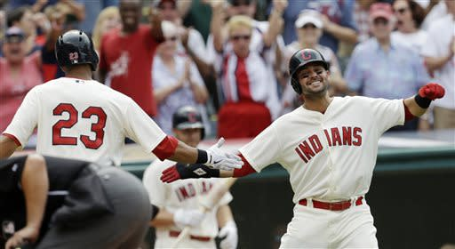 Cleveland Indians' Michael Brantley, left, is congratulated by Nick Swisher after Brantley hit a two-run home run off Detroit Tigers relief pitcher Al Alburquerque in the eighth inning of a baseball game, Sunday, July 7, 2013, in Cleveland. Swisher scored. The Indians won 9-6. (AP Photo/Tony Dejak)